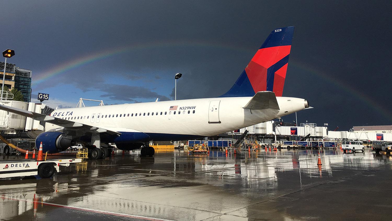 An airplane under a rainbow