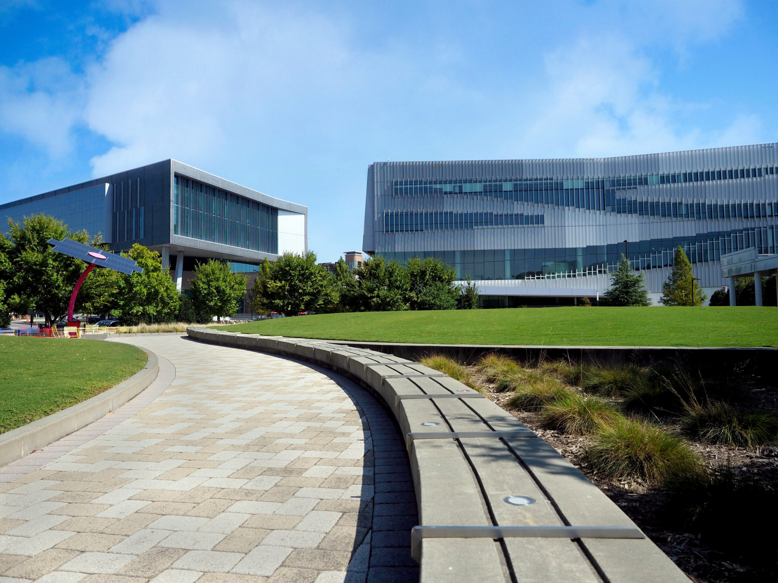 A walkway leads to the Hunt Library (right) and the newly completed Fitts-Woolard Hall on Centennial Campus.