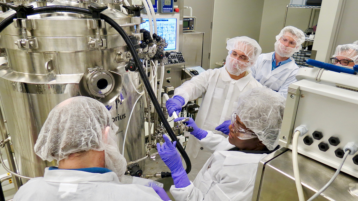 Participants in an upstream bioprocessing course complete a changeover procedure for the 300 L bioreactor in BTEC's pilot-scale upstream suite.